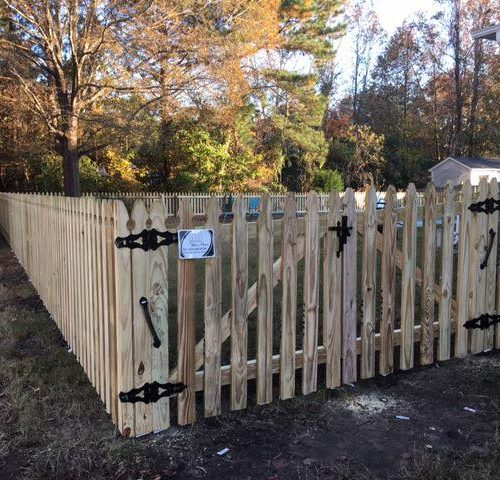 picket wood fence with gate