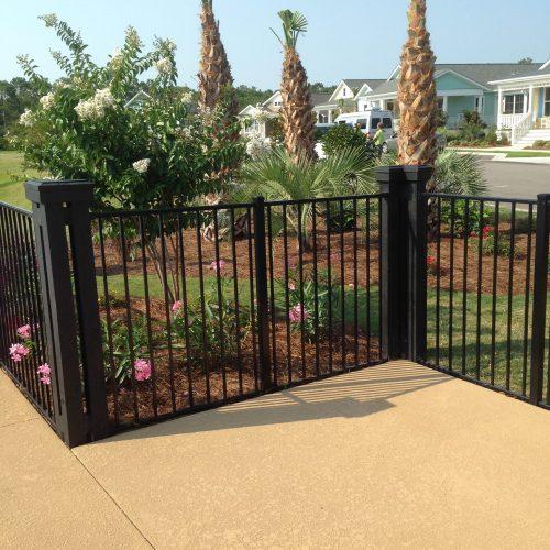 black ornamental fencing around garden